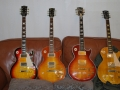 A 1959 Historic Reissue, A 2002 Standard AAA Flame Top, A 2004 Supreme AAAA Flame Top & A 2001 Classic 1960 Reissue